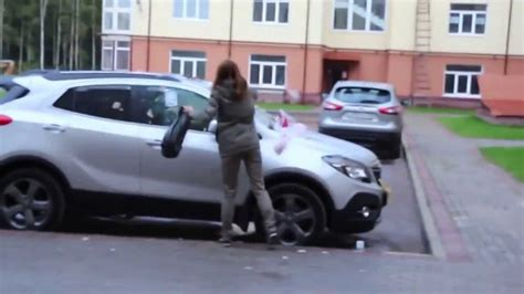 VIDEO | Girlfriend Trashes The Wrong Car After Finding Out