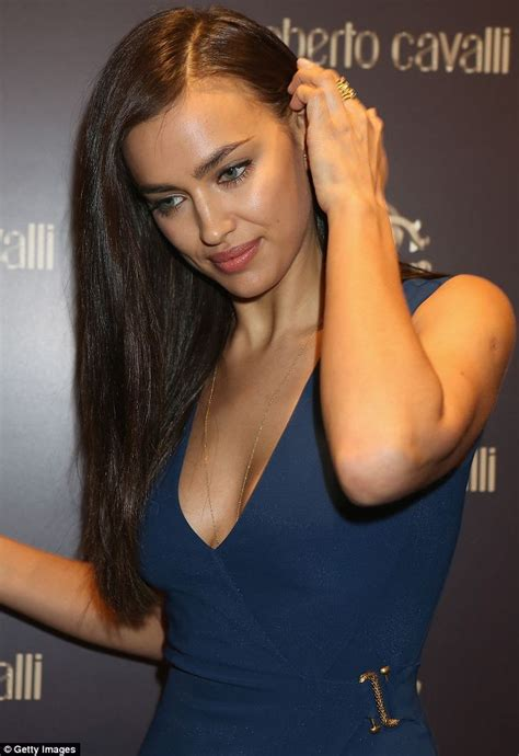 Irina Shayk wows in plunging deep blue gown and tuxedo