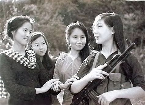 Việt Cộng female militia with a Type 56 assault rifle